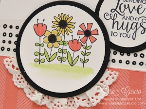 Bright flowers adorn this doily border. Circle images are easy to create using punches and dies. Garden Girl and Ribbon of Courage stamp sets by Stampin' Up!