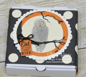 Polka dot designer paper band adorns the top of this Mini Pizza Box from Stampin' Up! and makes the perfect Halloween favor with an owl perched in a branch.