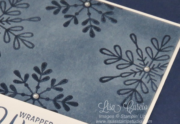Clear snowflakes created with an emboss resist technique. Video tutorial shows you how. Spotlight with Lisa.