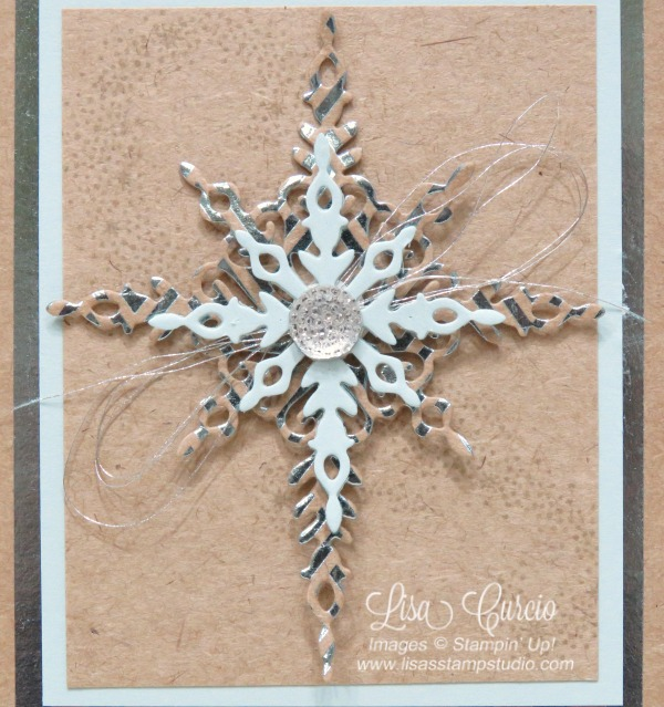 Beautiful star created with foil paper, metallic thread and a faceted gem that sits on top of a custom box sleeve to hold note cards. Stampin' Up!'s Star of Light stamp set.