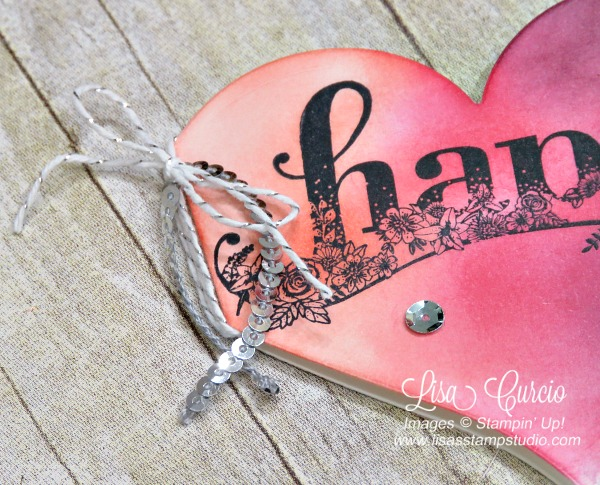 Close up view of mini sequins and silver baker's twine on the edge of a heart-shaped card with this video tutorial. Stampin' Up! Sweet & Sassy Framelits and Happy Wishes stamp set.