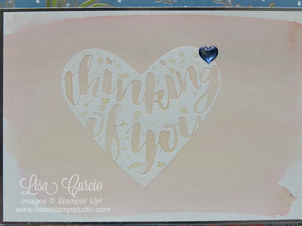 Close up of a watercolor washed resist heart. This video tutorial to teach you how to create watercolor wash backgrounds using Brusho. Stampin' Up!