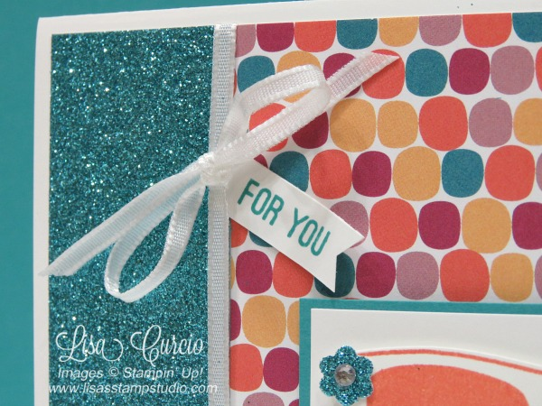 These sunglasses boast flowers and rhinestones on a colorful background of designer paper and glimmer paper. Pocketful of Sunshine from Stampin' Up! Close up view of ribbon and greeting.
