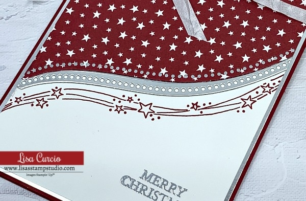 I used foil sheets to cut out the curve appeal on this Christmas card with stamped red stars
