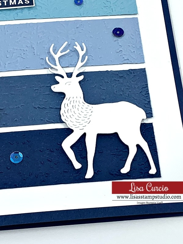 This DIY Christmas card is perfect for the men in your life with the deer and embossed snowflakes