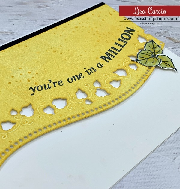 You're one in a million; curves and all in this die cut with green leaf embellishment