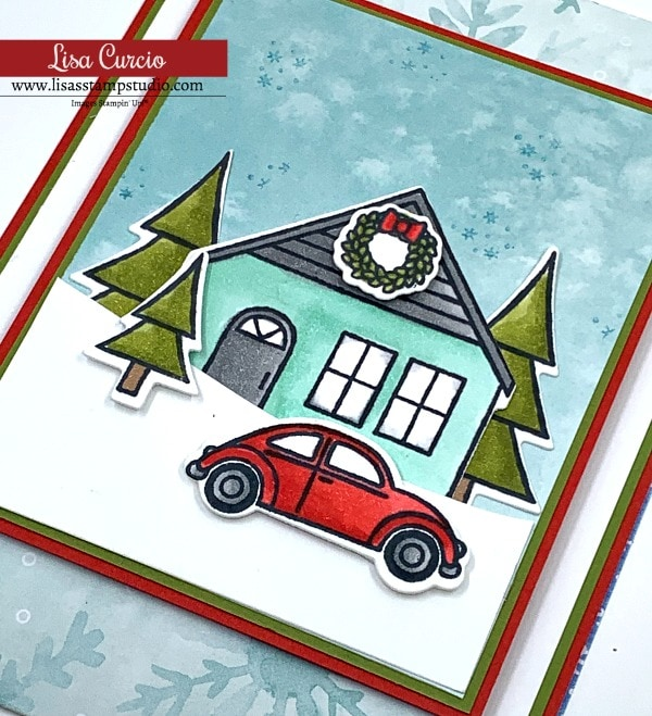 A pointed slide out fun fold card with holiday wreath on a house.