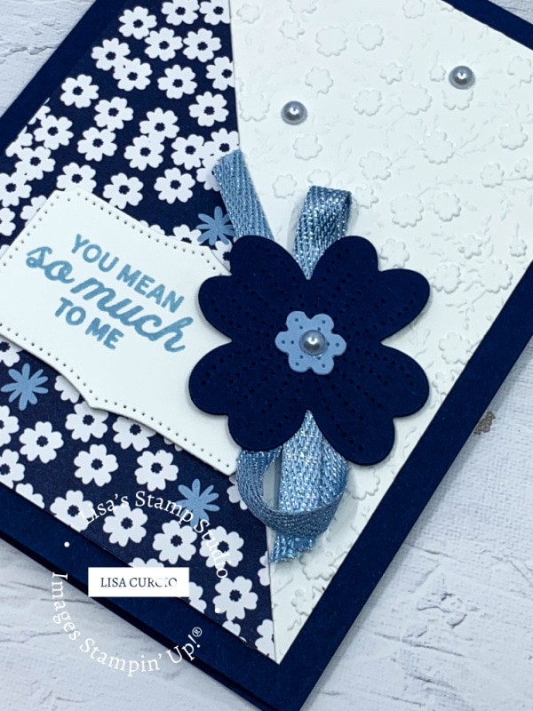 You can add a layer of dry embossed cardstock to really make your handmade card pretty
