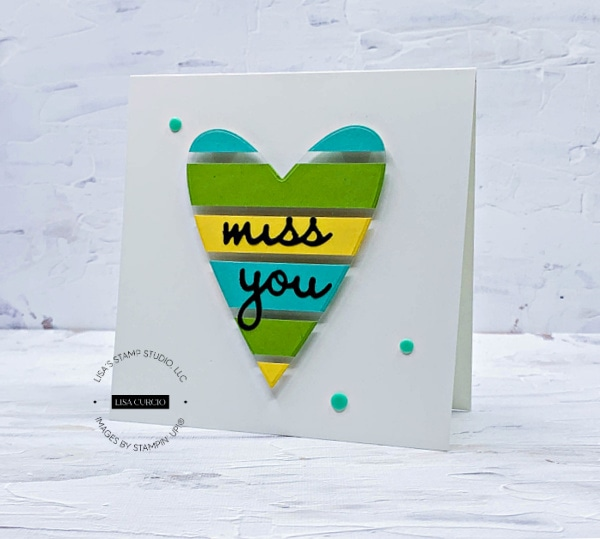 This heart shaped card is so fun with strips of teals, greens & yellows